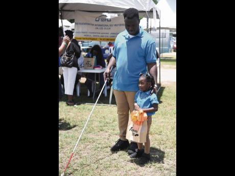 Shavane Daley and his daughter, Achaeya.