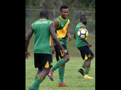 FILE National player Javain Brown (centre) takes part in a training session with the Jamaica Under-23 team.