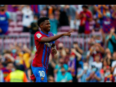 Barcelona's Ansu Fati celebrates after scoring his side's third goal during a Spanish La Liga  match between Barcelona and Levante at the Camp Nou stadium in Barcelona, Spain yesterday.