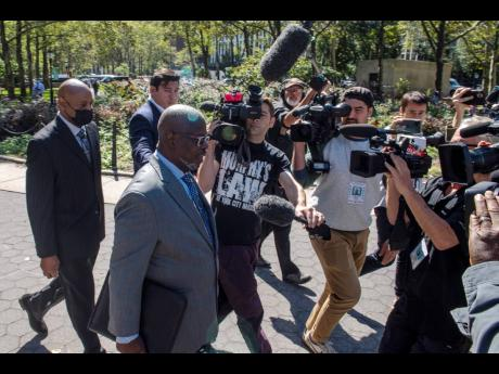 Deveraux Cannick, attorney for R. Kelly, is surrounded by the media during a break at the Brooklyn Federal Court House yesterday in New York.