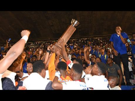 Members of the Jamaica College football team and supporters celebrate their win in the 2019 Manning Cup competition.